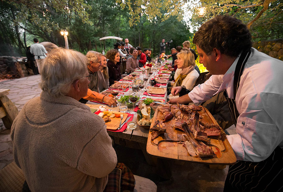 Guests enjoy the meal at the Patagonia River Ranch