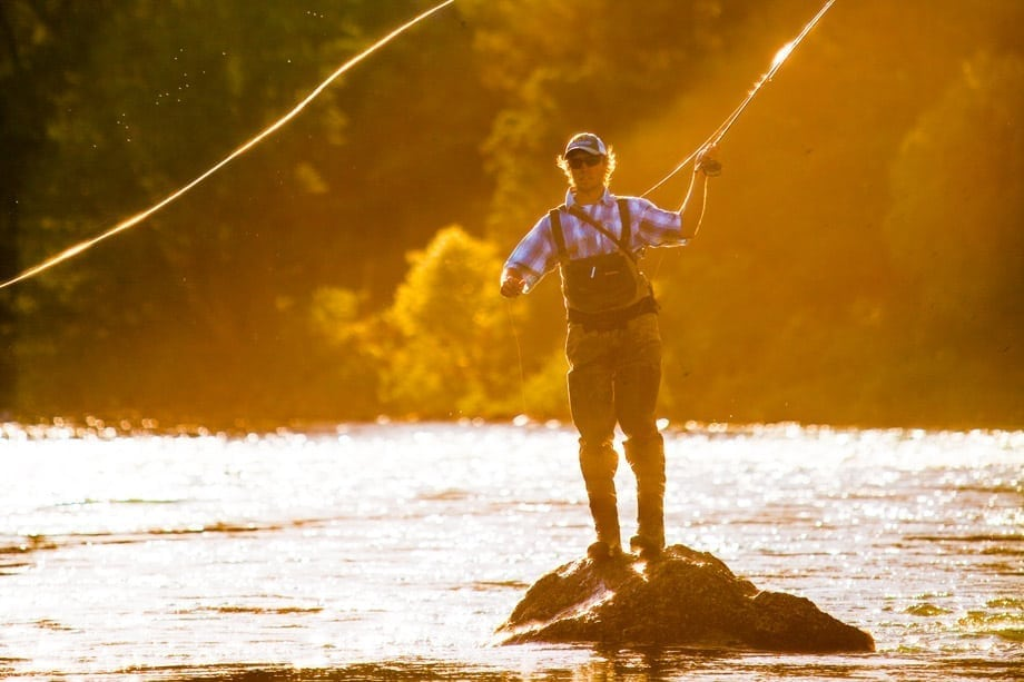 wade fishing at sunset